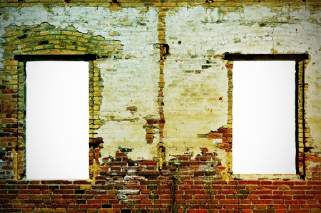 build up: an old brick wall with two windows with a blank space