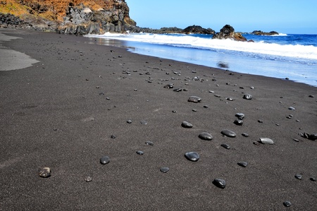 wild canary: A view of Bollullo Beach with black sand in Tenerife, Canary Islands, Spain