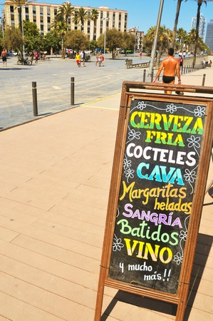 Barcelona, Spain - August 16, 2011: Blackboard with drinks on a terrace of a bar in Barceloneta District in Barcelona, Spain. This district houses a large number of bars and restaurants Stock Photo - 10500092