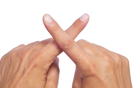 ex: man hands crossing fingers forming an x