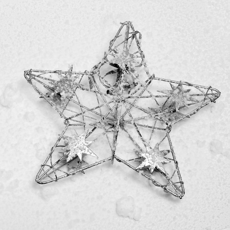 christmas ornamentation: a decorative christmas star on the snow