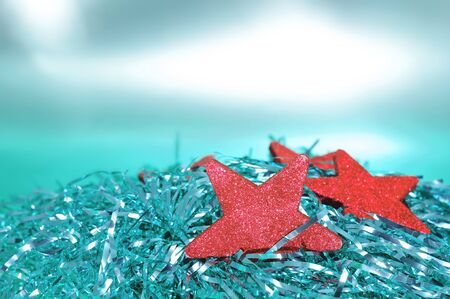 some red christmas stars with shiny tinsel Stock Photo - 10526926