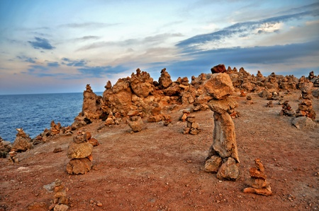 karesansui: a landscape with a lot of stone stacks in Menorca, Balearic Islands, Spain Stock Photo