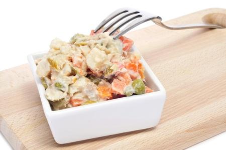 potato tuna: a bowl with ensaladilla rusa, russian salad, typical tapas in Spain