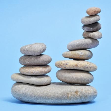 karesansui: a pile of zen stones on a blue background Stock Photo