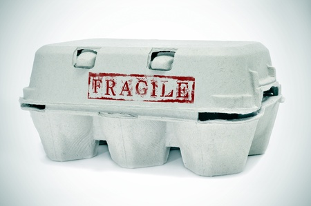 stamped: an egg carton with word fragile stamped on it Stock Photo