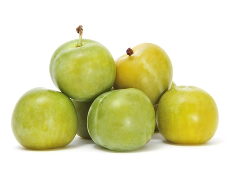 a pile of green plums on a white background photo