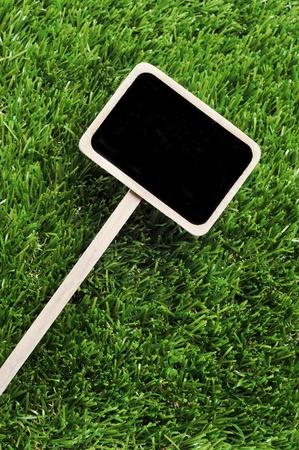 broaching: a blank blackboard label on the grass