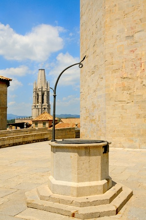 thirstiness: view  of a medieval water well in old town of Girona, Spain