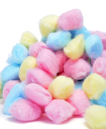 cosmetic lacquer: closeup of a pile of cotton balls of different colors