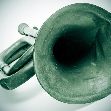 reveille: closeup of an old bugle Stock Photo