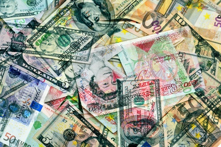 monetary devaluation: background of different banknotes, as dollar, euro and pound