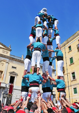 intangible: Tarragona, Spain - September 23, 2011: Castells in Tarragona, Spain. Every September 23, Santa Tecla holiday, those typical catalan human towers are performed in Plaza de la Font