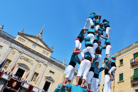those: Tarragona, Spain - September 23, 2011: Castells in Tarragona, Spain. Every September 23, Santa Tecla holiday, those typical catalan human towers are performed in Plaza de la Font