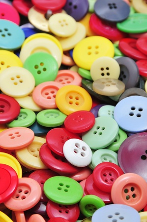 modiste: closeup of a pile of buttons of many colors Stock Photo