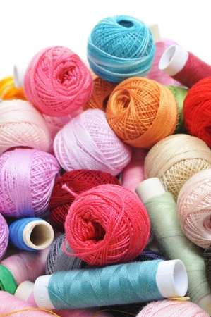 crochet: spools and balls of third of many colors on a white background Stock Photo