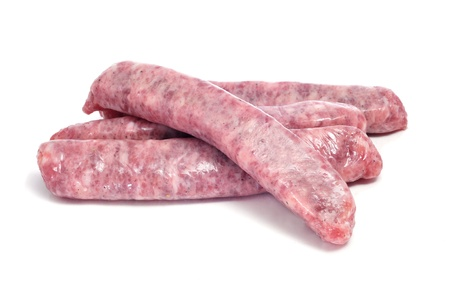 llonganissa: a pile of raw pork meat sausages on a white background