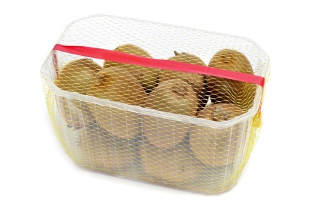 packaged: packaged kiwis on a white background