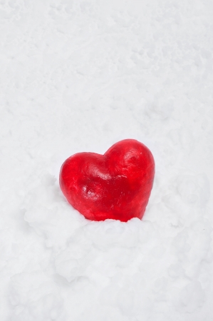 a red heart on the white snow photo