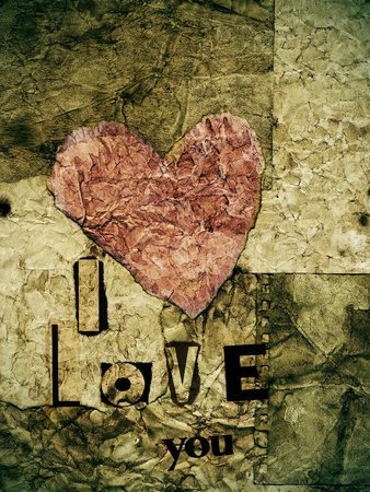 love message: i love you written with with newspaper clippings in a old paper background with a heart
