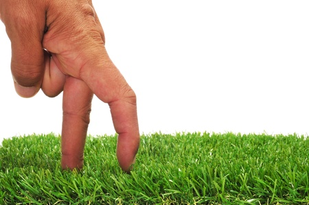 narrative: a man hand with its fingers simulating someone walking or running on the grass