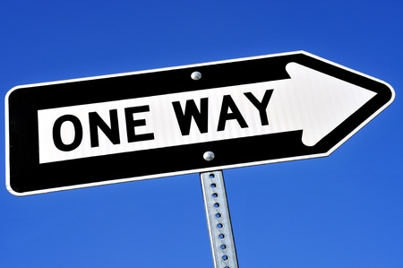 one way sign: a one way sign over the blue sky