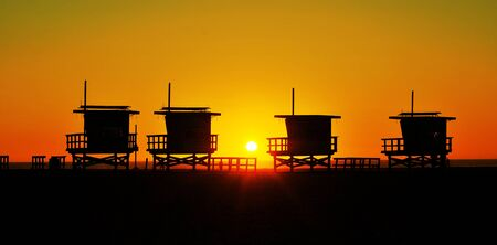 Lifeguard towers in Venice Beach, United States, at sunset