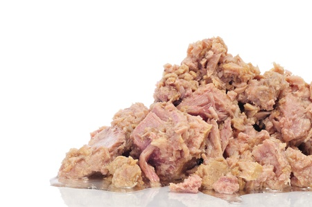 canned meat: a pile of tuna from a can on a white background
