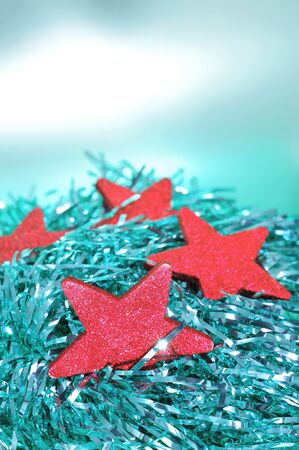 red christmas stars with blue tinsel on a blue background  photo