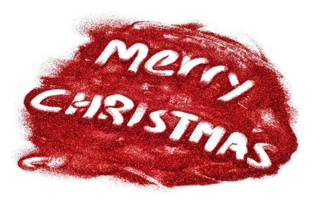 sentence merry christmas written with red glitter on a white background Stock Photo