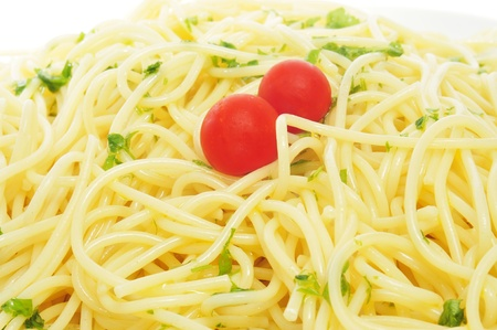 closeup of a pile of spaghetti with cherry tomatoes photo