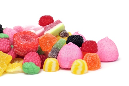colourful candy: a pile of candies on a white background