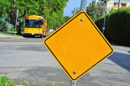 closeup of a blank traffic sign with a school bus in the background photo