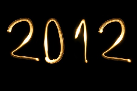 0 1 year: number 2012 written with light on a black background
