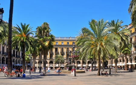 Barcelona, Spain - August 16, 2011: Plaza Real in Barcelona, Spain. The square, with lanterns designed by Gaudi and the Fountain of Three Graces in the center, has a lot of restaurants