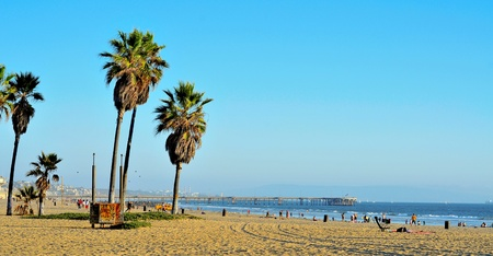 Venice, US - October 17, 2011: View of Venice Beach with its Pier in the background in Venice, US. Dozen of movies are filmed in the Venice Pier, a 1,310-foot (400 m) concrete structure