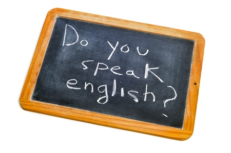 sentence do you speak english? written with chalk on a blackboard photo
