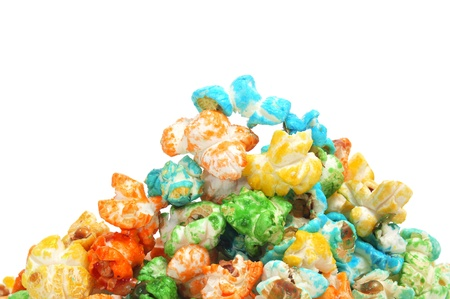 flavoured: a pile of caramel corn of different colors on a white background Stock Photo