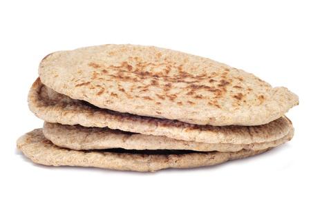 pita: a pile of pita breads on a white background Stock Photo