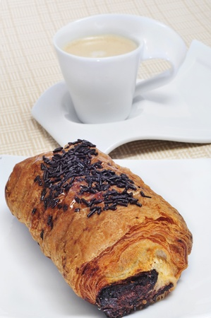 an exemple of continental breakfast: pain au chocolat and cappuccino photo