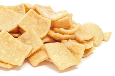 chicharon: a pile of wheat snacks on a white background