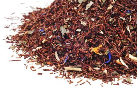 rooibos tea: a pile of rooibos tea on a white background Stock Photo