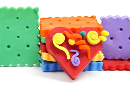 a pile of plasticine handicrafts, as a heart and cookies of many colors photo