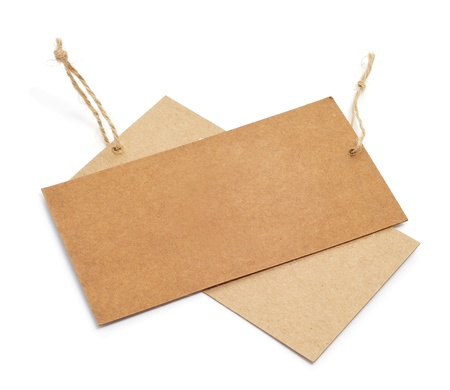 labelling: a pair of blank paper labels on a white background
