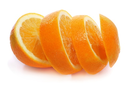 an orange cut in slices on a white background