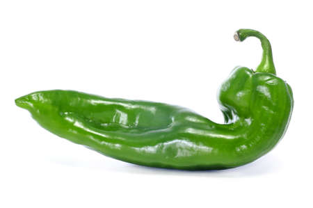 a green pepper with a rare shape on a white background Stock Photo - 11325885