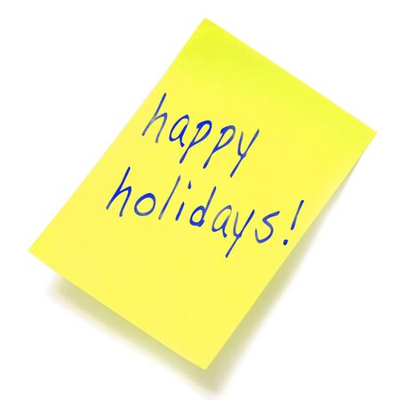 happy holidays written in a yellow sticky note Stock Photo - 11325884