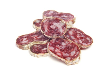embutido: a pile of slices of fuet, a typical spanish salami