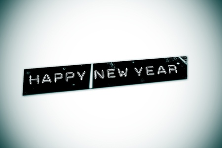 embossing: happy new year written in an embossing tape Stock Photo