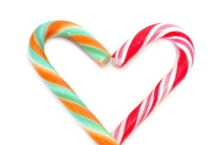 two candy canes forming a heart on a white background photo